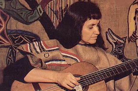 Violeta Parra playing guitar